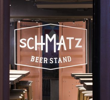 I IN repurposes a shipping container to form the SCHMATZ beer stand in tokyo