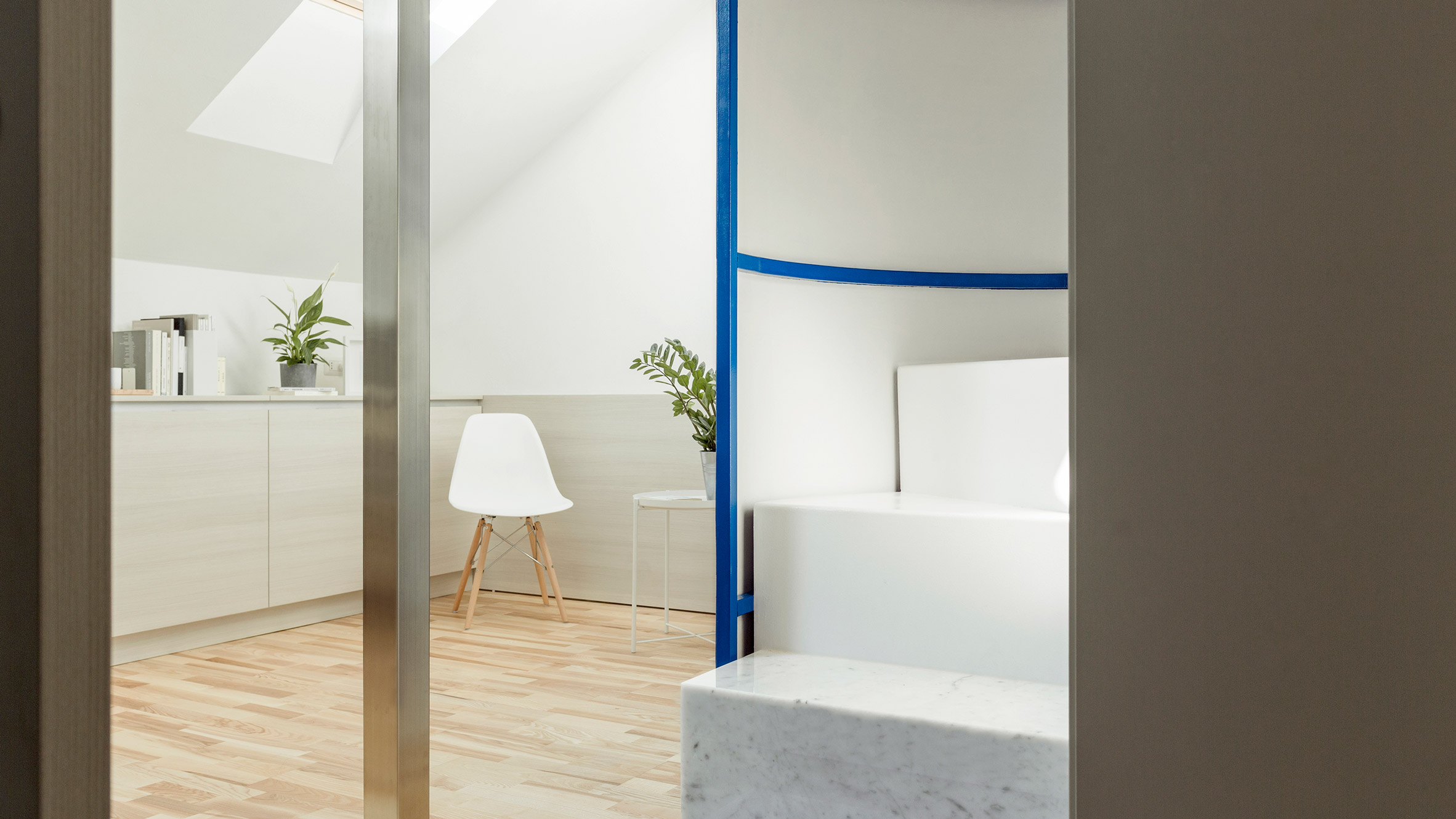Untitled Architecture completes overhaul of attic apartment in Milan