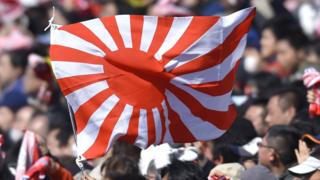 Tokyo 2020: Why some people want the rising sun flag banned
