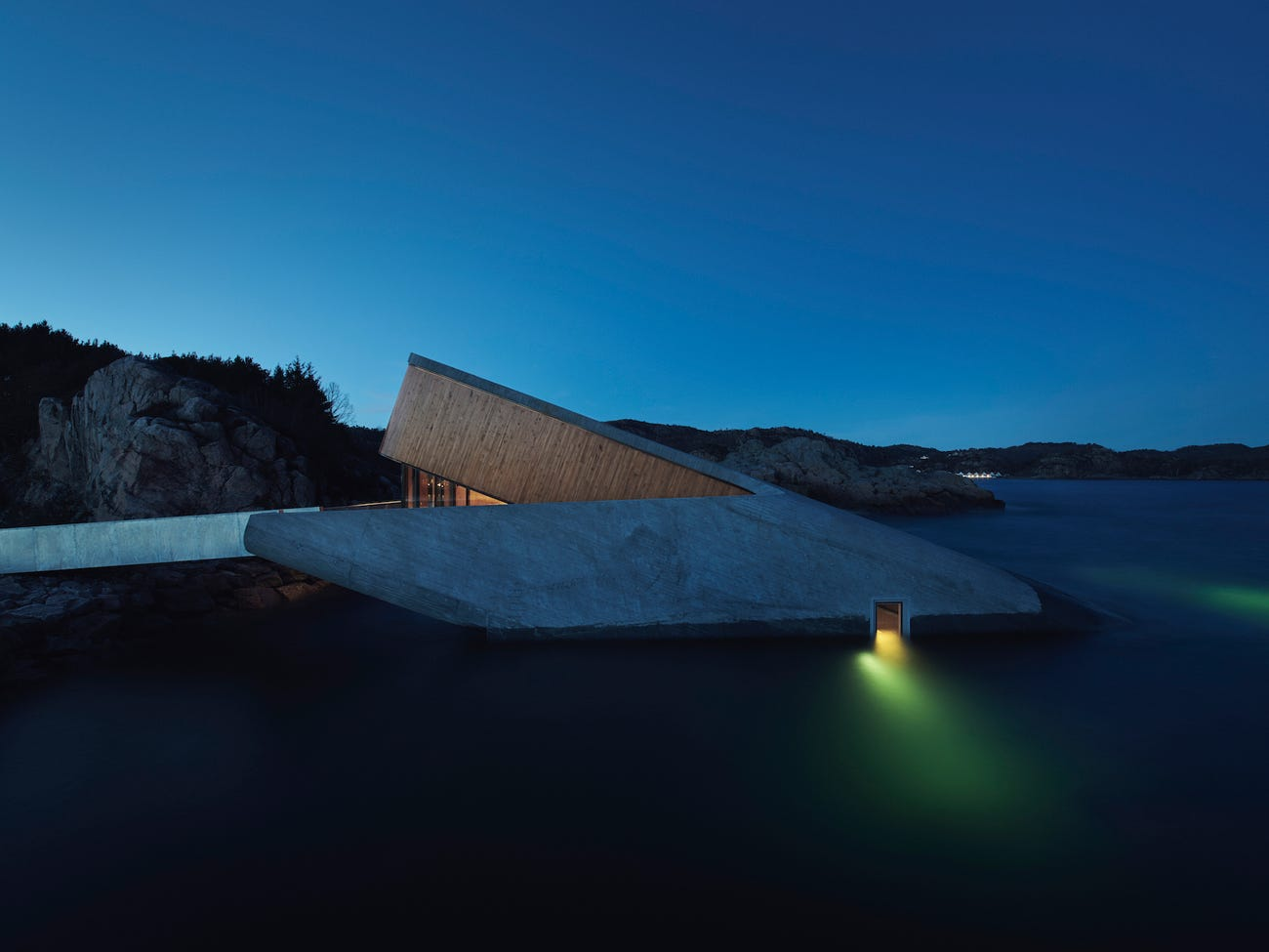 The world's largest underwater restaurant in Norway was just named one of the 'world's greatest places.' Take a look inside, where diners can watch marine life swim by through a 36-foot window.
