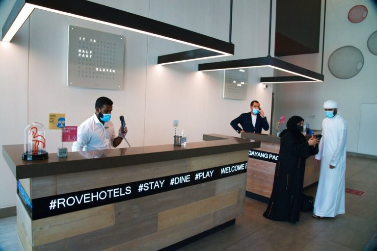 Thermometers in hand, Dubai opens for tourists amid pandemic