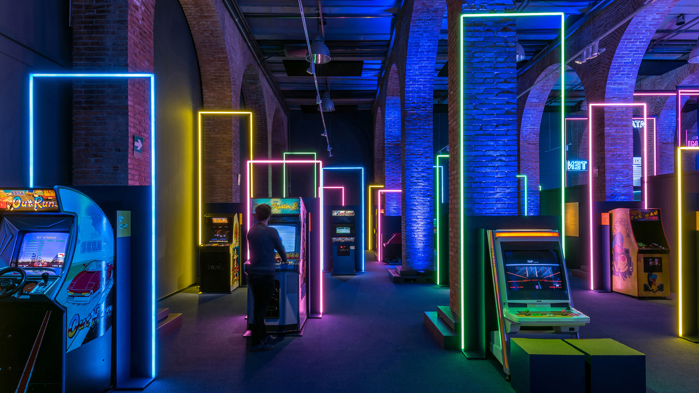 Game On's neon-filled exhibition design pays homage to 80s video games